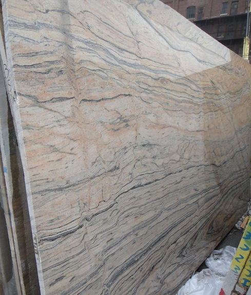 Granite That Looks Like Marble : Colonial gold won for counter in rental beating upwind