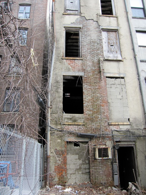 dilapidated rear wall on harlem townhouse shell