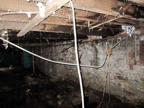 Run down cellar in a townhouse shell
