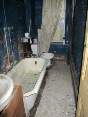 Delapidated wreck of a bathroom in a Harlem townhouse