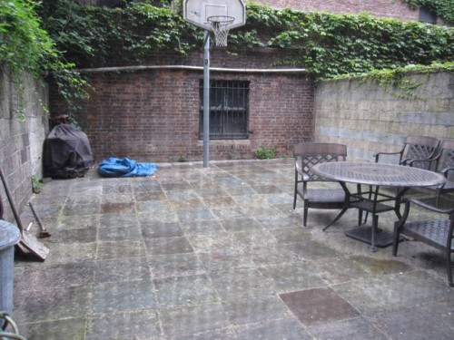 Back yard with basketball hoop