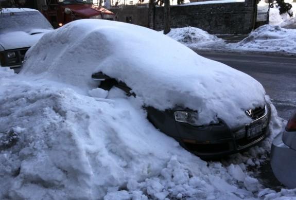 Snow covers car in Upper Manhattan
