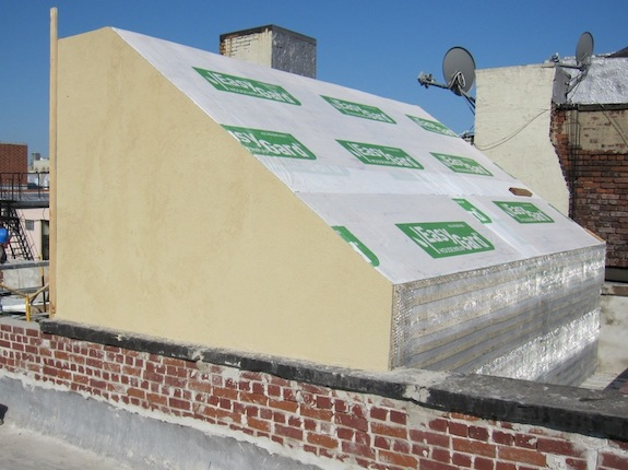 Bulkhead roof with stucco partially finished