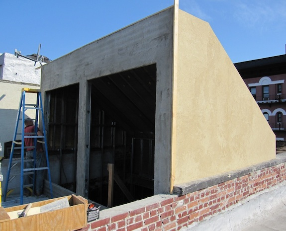 Bulkhead with stucco being applied