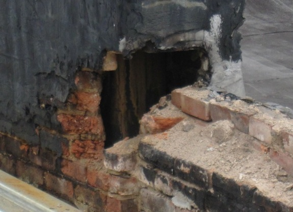 hole in brick chimney