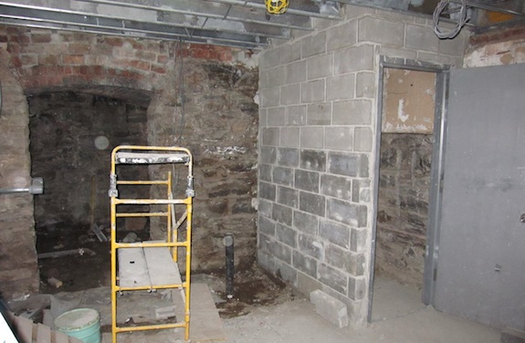 Concrete wall around cellar stairs in Harlem Brownstone