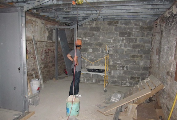 Cellar storage area with rock and concrete block walls