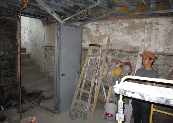 Cellar storage area with entrance under stoop