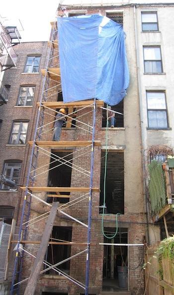 Cleaning and repointing brick on Harlem townhouse