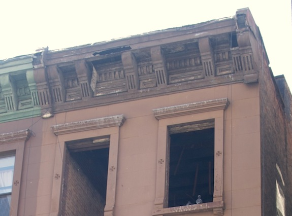 Crumbling cornice on Harlem Townhouse