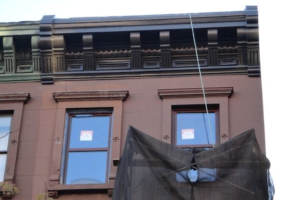 Restored cornice on Harlem brownstone
