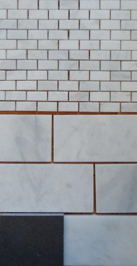 Carrara subway tile and mini bricks for master bathroom