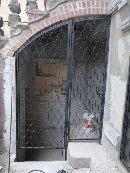 new under stoop gates on Harlem brownstone